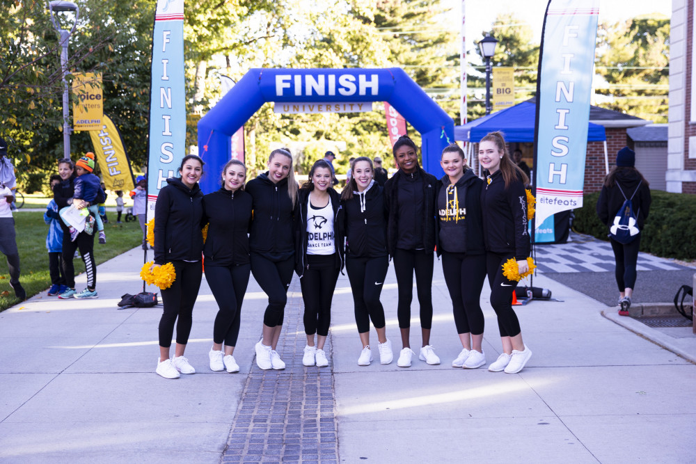 Runners at the finish line of Adelphi University Panthers for a Cause 5K and Fun Run.